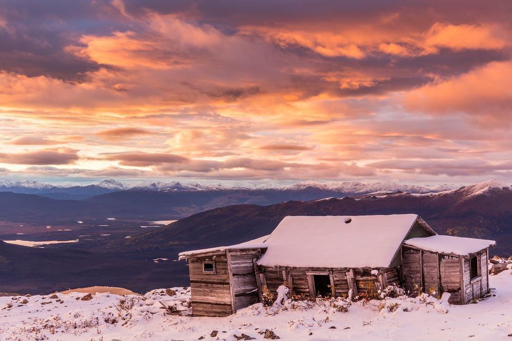 Sunset at abandoned sheep herding shack in the mountains of the Yukon Territory, Canada_shutterstock_592228745.jpg