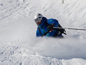 Free rider makes a bend in deep snow_shutterstock_557399287.jpg