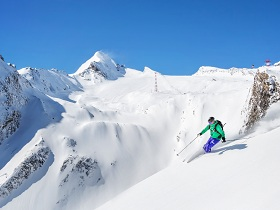 Freeride skiier in the mountains_shutterstock_229894309.jpg